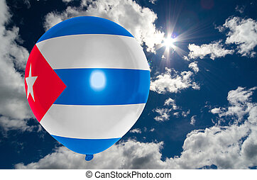 balloon in colors of cuba flag flying on blue sky