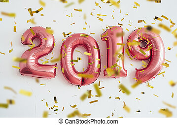Balloons 2019 confetti Christmas and new year celebration.