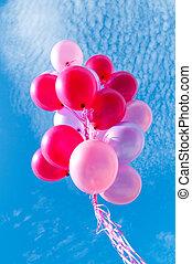Balloons Against Blue Sky