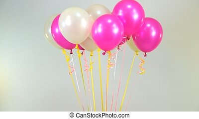 balloons fly with a rose