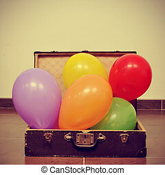 balloons in an old suitcase