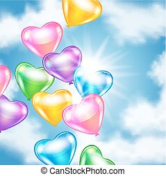 Balloons in shape of heart in the sky