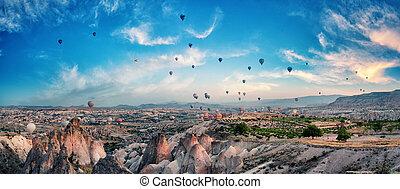 Balloons in the cloudy sky over Cappadocia