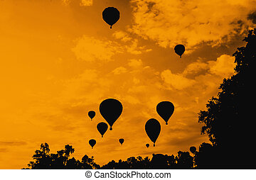balloons in the sky at evening