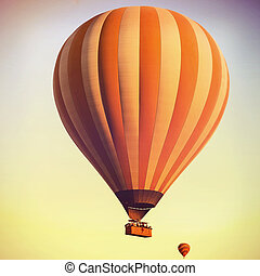 Balloons in the sky at sunrise. Vintage retro style