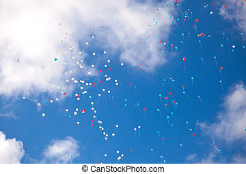balloons in the sky with clouds