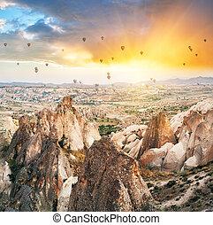 Balloons in the sunset sky over Cappadocia