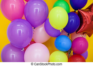 balloons of different colors with gifts for the holiday