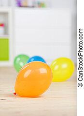 Balloons On Hardwood Floor