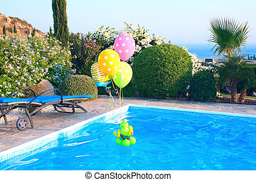 Balloons on swimming pool - Colorful balloons on swimming...