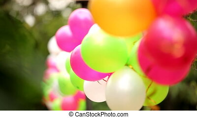 Several colorful festive balloons fastened together. Two frame.