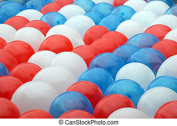 Balloons - Shot of several balloons, red, blue, and white ...