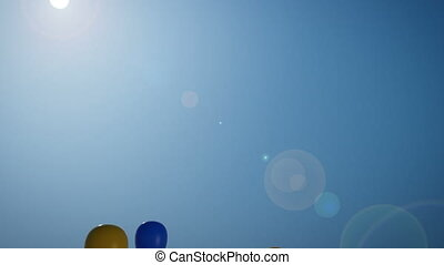 1080p HD Stock Video of multi-colored balloons flying up into the deep blue sky