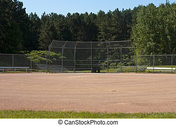 ballpark - small rural baseball field with trees in the...