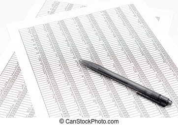 Ballpoint and Accounting documents - The close-up of a the ...