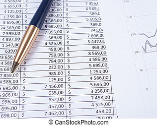 Ballpoint pen lying in a corner on printed financial tables