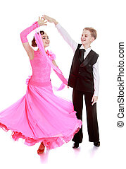 Ballroom dancing - Beautiful young couple dancing at...