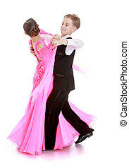 Ballroom dancing - Young dancers move to the beat of the...