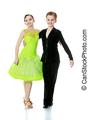 Ballroom dancing - Young couple dancing in costumes for a...