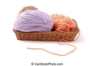 Balls of a yarn knitting  in wooden box