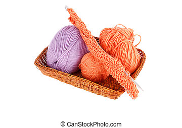 Balls of a yarn knitting in wooden box on white background