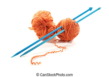 Balls of a yarn knitting spokes on white background