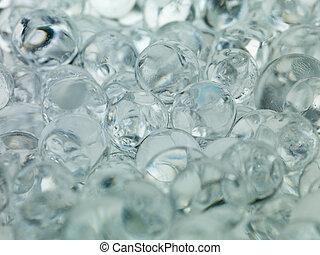 balls of ice cold transparent translucent gray macro