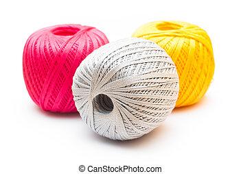 Balls of knitting yarn on white background