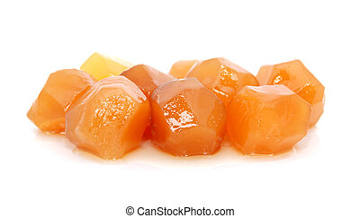 Balls of preserved ginger, isolated on a white background