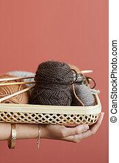 Balls of yarn in basket