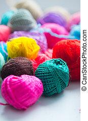 Balls of yarn on white background