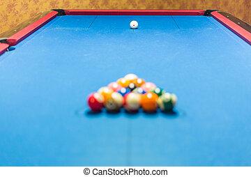 Balls racked on pool table