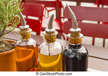balsamic vinegar bottles and condiments on the table in an...