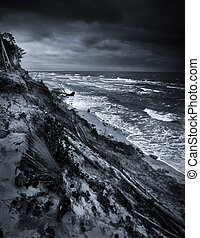 Black and white photo of eroded coast at baltic sea due climate change