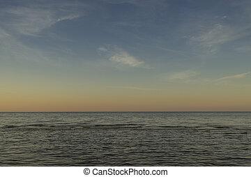 Baltic sea at beautiful sunrise in Latvia beach.