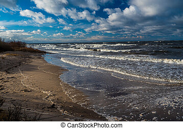 Baltic sea beach with blue cloudy sky