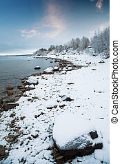 Baltic Sea in winter. snow on a background of water