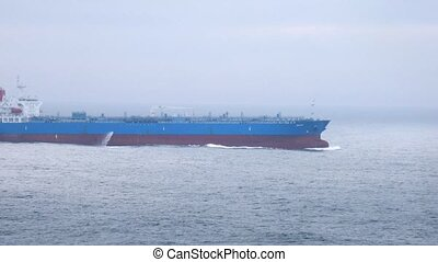 Tanker ship left behind by cruise liner