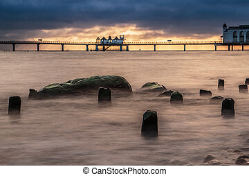 baltic sea on morning by sunrise with landing stage