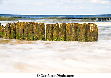 Baltic Sea with groins and turf in longtime exposure