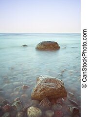 Baltic seascape with stones. Sea coastline at sunny day