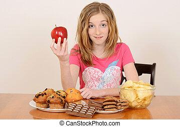 bambino, con, mela, e, cibo spazzatura
