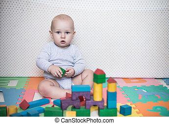 bambino, giochi, con, blocchi giocattolo