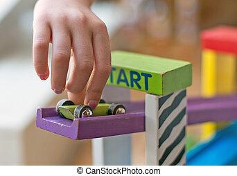 bambino, mano, gioco, con, giocattolo, blocks.