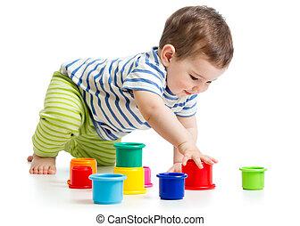 bambino primi passi, ragazzo, gioco, con, tazza, giocattoli