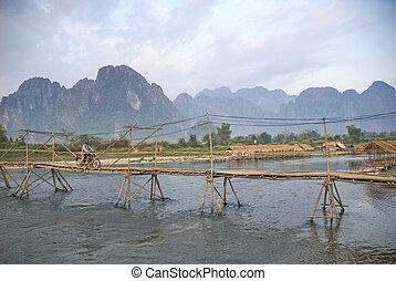 bamboo and wood bridge in vang vieng laos