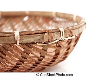 Bamboo basket over white background
