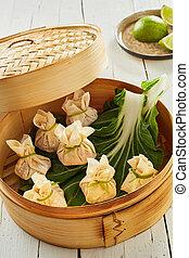 Bamboo basket with dim sum dumplings