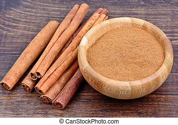 Bamboo bowl with cinnamon on table