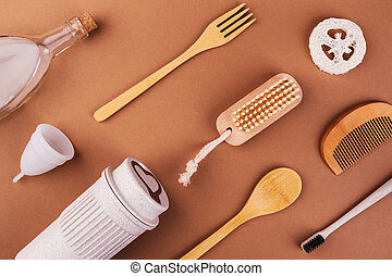 Bamboo cutlery, organic products on brown background - ...